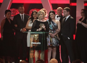 EastEnders scoops the award. The cast and crew pile on stage to say their thankyous.