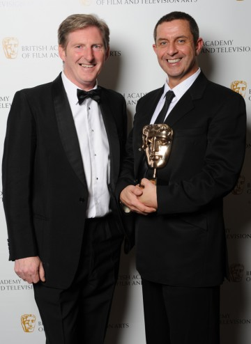 Special Award recipient Aidan Farrell celebrates his award with presenter Adrian Dunbar.