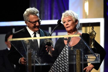 Actor Dustin Hoffman (L) presents the Albert R. Broccoli Britannia Award for Worldwide Contribution to Entertainment to honoree Dame Judi Dench