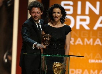Luther's Indira Varma and Prince of Persia actor Richard Coyle present the award for Single Drama. (BAFTA/Steve Butler)