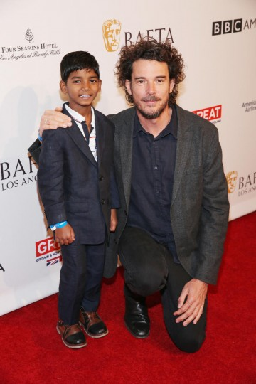 Director Garth Davis and actor Sunny Pawar from the film Lion pose together on the BAFTA Tea red carpet