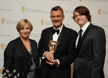 BAFTA-winning writer Peter Bowker with Eric And Ernie exec producer Victoria Wood and star Daniel Rigby. (Pic: BAFTA/Chris Sharp)