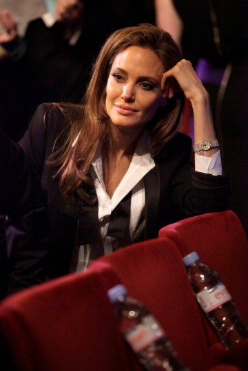 Angelina Jolie takes to her seat for the EE British Academy Film Awards in 2014