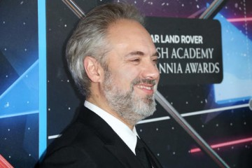 Honoree Sam Mendes smiles on the red carpet ahead of the ceremony.