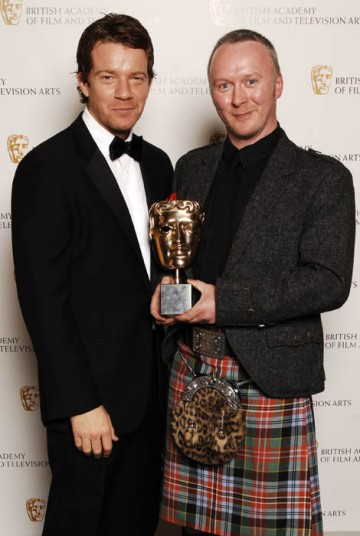 Neville Kidd celebrates his Photography Factual win for A History of Scotland (BAFTA / Richard Kendal).