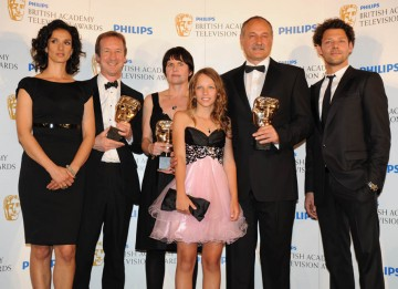 The Unloved team receives their BAFTA for Single Drama from presenters Richard Coyle and Indira Varma (BAFTA/Richard Kendal).