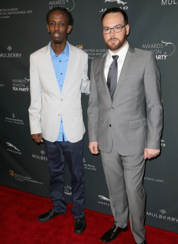 Actor Barkhad Abdi and producer Dana Brunetti arriving at the BAFTA LA 2014 Awards Season Tea Party.