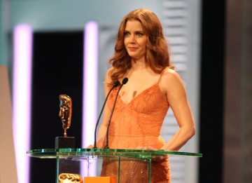 Amy Adams (The Fighter) reveals the Leading Actor winner. (Pic: BAFTA/ Stephen Butler)