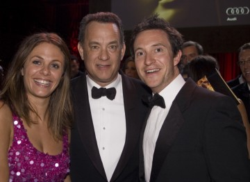 Tom Hanks poses with guests at the Brits to Watch party