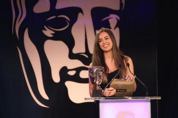 Georgia May Foote presents the award for Persistent Game at the British Academy Games Awards Ceremony in 2015