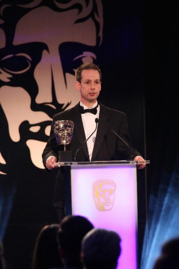 Martin Hollis presents the award for Story at the British Academy Games Awards Ceremony in 2015