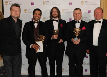 Charlie Booker and Ian Livingstone presented the Artistic Achievement Award to Kareem Ettouney, Mark Healey and Leo Cubbin for LittleBigPlanet (BAFTA / James Kennedy).
