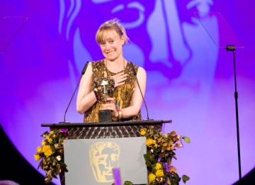 Natalie Ward celebrates winning the hotly contested Costume Design caetgory for her work on 1970s serial killer drama, Red Riding.