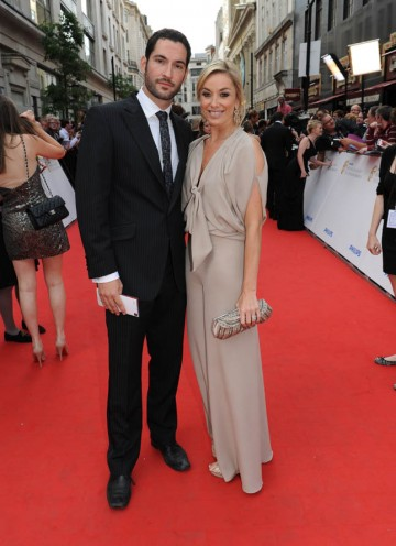 Sweet Charity star Tamsin Outhwaite arrives on the red carpet with her husband, Miranda actor, Tom Eliis. (BAFTA/Richard Kendal).