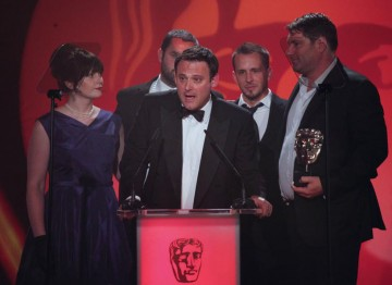 Visual effects agency The Mill collect this award for their VFX work on Merlin. (Pic: BAFTA/Jamie Simonds)