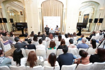 Hemming speaks to a packed audience at The Peninsula Hotel in Hong Kong