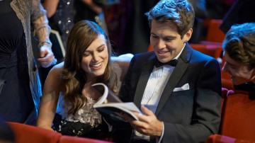Keira Knightley and James Righton enjoy the official programme in the Royal Opera House Auditorium.
