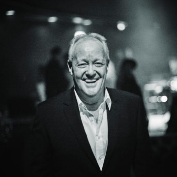 Former ceremony host Keith Chegwin smiles backstage