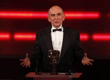 Creator of Populous, Theme Park and the Fable series Peter Molyneux accepts his BAFTA Fellowship. (Pic:BAFTA/Brian Ritchie)