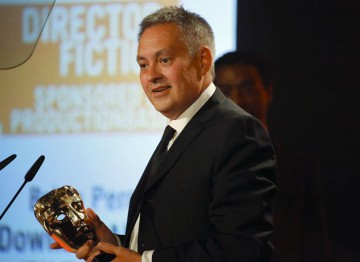 Brian Percival accepts the award for his direction of fictional period drama Downton. (Pic: BAFTA/Jamie Simonds)