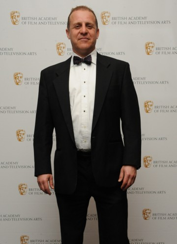 Actor Nigel Lindsay (pictured) announced Jason Savage as the winner, for his work on the Arctic episode of Human Planet. (Pic: BAFTA/Chris Sharp)