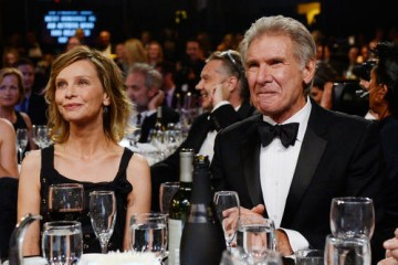 Harrison Ford enjoys the ceremony with his wife, actress Calista Flockhart.