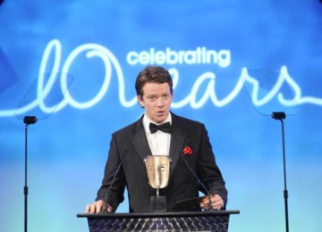 Hotel Babylon star Max Beesley took to the stage at the London Hilton Hotel to present the Photography Factual award (BAFTA / Richard Kendal).