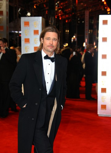Pitt's nomination for Leading Actor in baseball drama Moneyball is his fourth BAFTA nomination to date, including one for producing The Departed. Pitt is wearing Gucci.