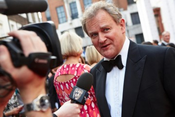 Hugh Bonneville is interviewed on the red carpet ahead of the House of Fraser British Academy Television Awards in 2015.
