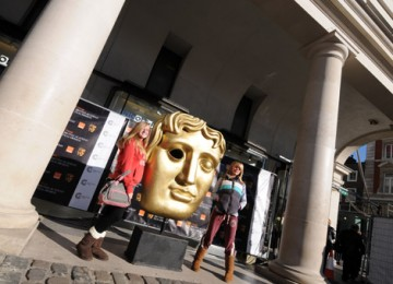 Film fans pose next to a giant BAFTA Mask in the Covent Garden Piazza (pic: Marc Hoberman).