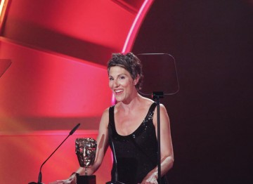 British Actress and comedienne Tamis Greig announces the nominations for the Writer Award on the Television Craft stage. (Pic: BAFTA/Jamie Simonds)