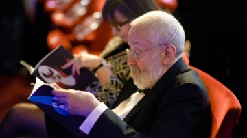 BAFTA Fellow Mike Leigh enjoys the official programme in the Royal Opera House Auditorium.