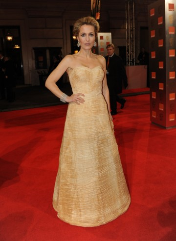 The X Files actress, most recently seen in Great Expectations and Johnny English Reborn, will present the BAFTA for Animated Film. She is wearing Vintage Sybil Connolly Haute Couture 1956.