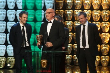 Dan Reed, Mark Towns and Tom Costello accept the award for Single Documentary
