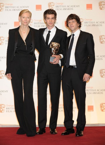 The Social Network stars Andrew Garfield and Jesse Eisenberg with citation reader Tilda Swinton, collecting David Fincher's BAFTA for Director. (Pic: BAFTA/ Richard Kendal)