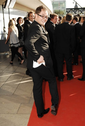 Alan Carr, nominated in the Entertainment Programme for The Friday/Sunday Night Project, strikes a cheeky pose in an Alexander McQueen suit (BAFTA / Richard Kendal).