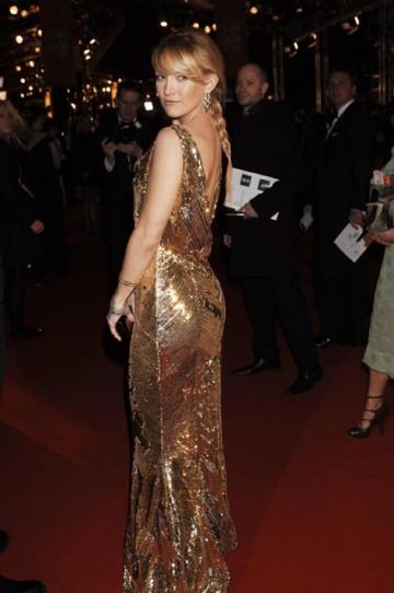 Kate Hudson wore a stunning dress with gold beading by Stella McCartney with Bulgari earrings (pic: BAFTA / Richard Kendal).