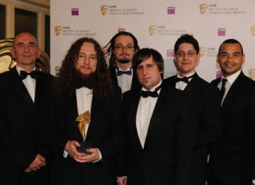 CBBC presenter Michael Underwood and Populous creator Peter Molyneux presented the BAFTA Ones To Watch Award to Boro Toro creators Adam Westwood, Graham Ranson, Yves Wheeler, Matthew Booton and Owen Schwehr (BAFTA / James Kennedy).