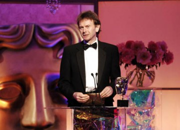Globetrotting broadcaster Michael Wood presents the Award for Editing Factual (pic: BAFTA / Richard Kendal).