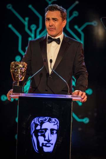 A suave Nolan North presents the award for British Game