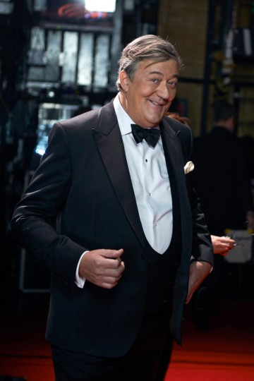 Ceremony host Stephen Fry poses backstage at London's Royal Opera House.
