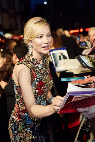 Nominated for her leading role in Carol, Cate Blanchett signs autographs for fans on the red carpet