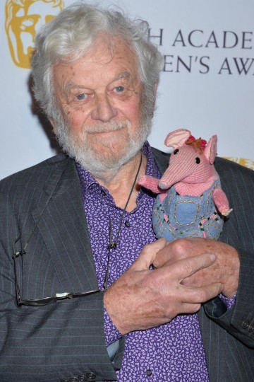 Special Award recipient Peter Firmin, the creator of the Clangers and Bagpuss among other classic characters, arrives at British Academy Children's Awards in 2014 -- with a tiny guest!
