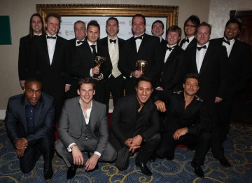 Presenters Blue with the winning team behind the hugely popular social multiplayer. (Pic: BAFTA/Steve Butler)