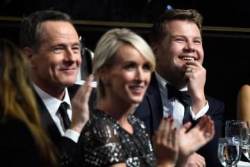 Actor Bryan Cranston, Julia Carey, and honoree James Corden watch the ceremony.