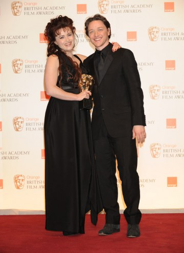 Presenter James McAvoy with The King's Speech's Supporting Actress winner Helena Bonham Carter. (Pic: BAFTA/ Richard Kendal)