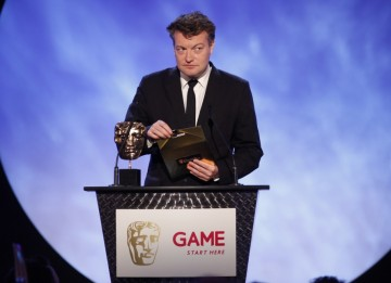 Journalist, comic writer and broadcaster Charlie Brooker announces the penultimate award of the evening, Best Game (BAFTA/Brian Ritchie)