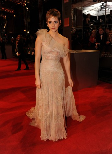 Best-known as Hermione in the Harry Potter films, Watson will present the Outstanding British Film award. Watson is wearing a one shoulder ivory lace dress by Valentino. (Pic: BAFTA/Richard Kendal)
