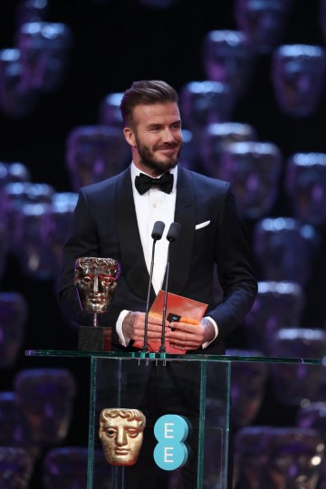 David Beckham takes to the stage to present the award for Outstanding British Film