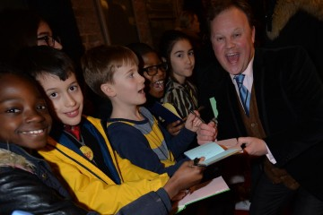 Justin Fletcher poses with fans